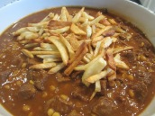 Place the khoresht in a serving bowl, top with fries just before serving.